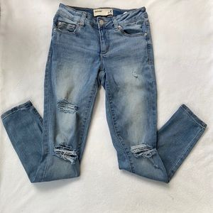 Distressed ripped jeans